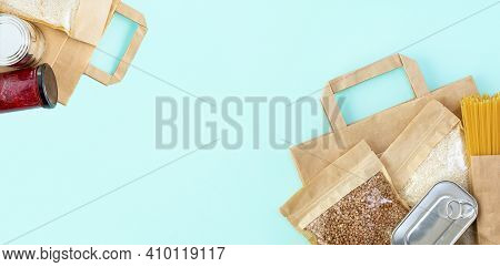 Donation Food On Mint Color Background With Copy Space. Flat Lay. Top View, Mock Up. Rice, Canned Fo