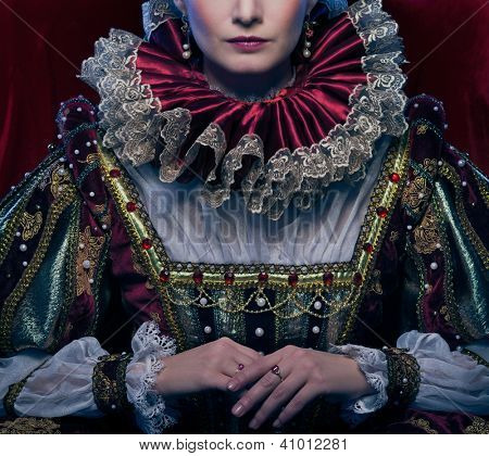 Queen in royal dress and luxuriant collar poster