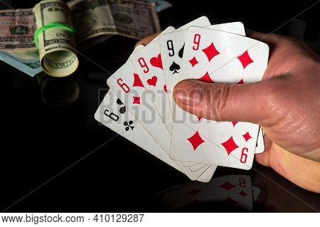 Poker Cards With Full House Or Full Boat Combination. Closeup Of A Gambler Hand Is Holding Playing C