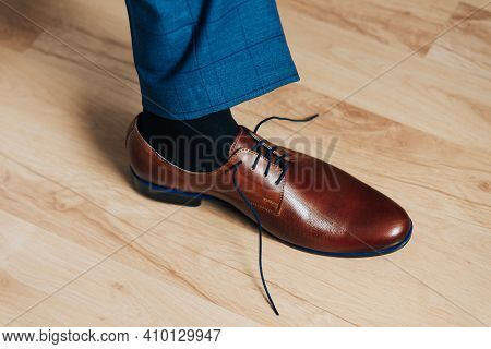 Brown New Mens Shoes On The Floor