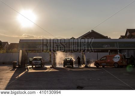 Belgrade, Serbia - April 7, 2019: People Washing Their Cars With High Pressure Water Hoses In A Car