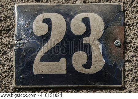 Weathered Grunge Square Metal Enamelled Plate Of Number Of Street Address With Number 23