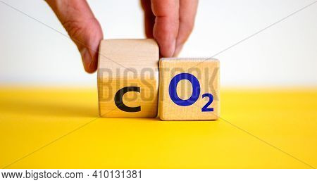 Co2 Or O2 Symbol. Businessman Turns The Wooden Cube And Changes Words 'co2, Carbon Dioxide' To 'o2,