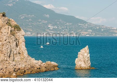 Crimea. Rock Sail In The Sea On The Background Of The Southern Coast On A Sunny Day.