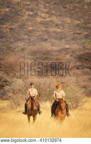 Two Women Ride Through Savannah In Sunshine