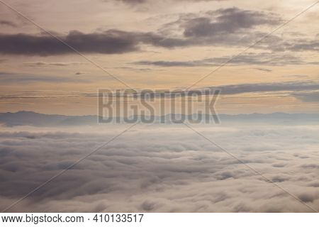 Mist On Mountain Under Cloudy At Morning Time
