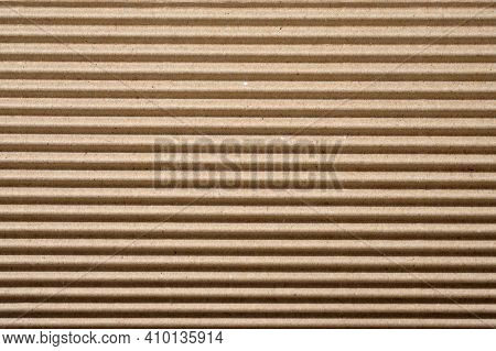 Corrugated Board Close Up Background. Cardboard Packing Material Texture. Cardboard For Use As Packa