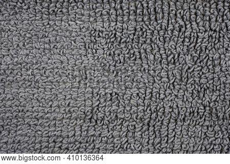 The Woven Backing Of A Bath Rug In Closeup. Gray Cotton Texture Rug Top View.