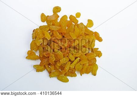 Yellow Raisins Of Medium Size From One Grape Of White Grapes. Raisins On A White Background Top View