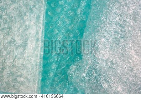 Air Bubble Wrap Of Different Density And Color Top View. Green Bubble Wrap Texture, Background.