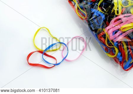 Silicone Hair Rubber Bands On A White Background. Multicolored Elastic Bands For African Braids And