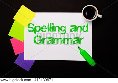A Sheet Of Paper With The Spelling And Grammar, A Cup Of Coffee, Bright Multi-colored Stickers For N