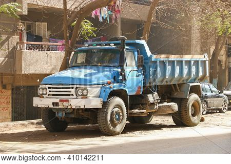 Cairo, Egypt - January 26, 2021: Old Blue Dump Truck In The City Street.
