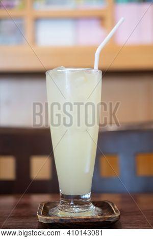 Yuzu Orange Juice With Ice On Wood Table In Restaurant