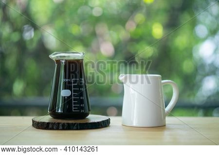 Black Coffee In Shot And Fresh Milk In Mini Ceramic Jar On Wood Table In The Morning