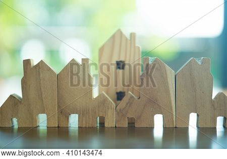 Wooden Flat Home Village Set On Wood Table. Ideas House Concept
