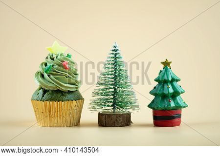 Cupcake Christmas Tree And Toy Christmas Tree On A Yellow Background For Decoration