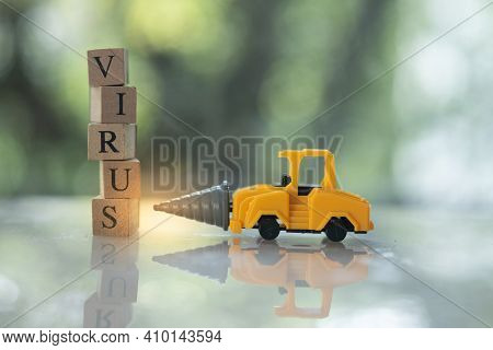Toy Drill Car Kill To Virus Text In Wooden Blocks. Beat Virus Concept. People Fight Virus Concept.