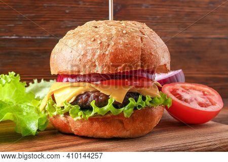 Homemade Hamburger With Cutlet, Salad, Onion, Tomato And Cheese. Cheeseburger, Burger. Close-up Of H