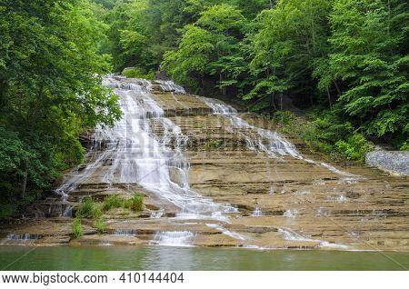 Enfield Falls On Enfield Creek Cascades  Through A Lush Green Forest, Robert Treman State Park, Tomp