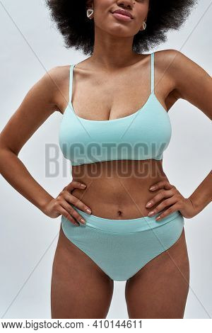 Body Closeup Of Perfect Voluptuous Young Female Model With Afro Hair Wearing Blue Underwear Posing F