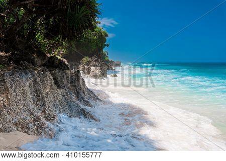 Tropical Beach In Bali. Paradise Beach And Blue Ocean With Waves