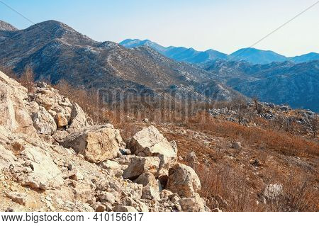 Beautiful Mountain Landscape In Autumn Colors. View Of Mountain Range Of Dinaric Alps  On Sunny Day.