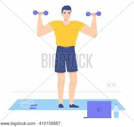 Man Standing On Mat Lifting Dumbells During Watching Education Video. Online Workout, Muscle Gains,