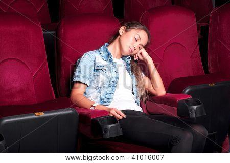 attractive woman asleep in the cinema