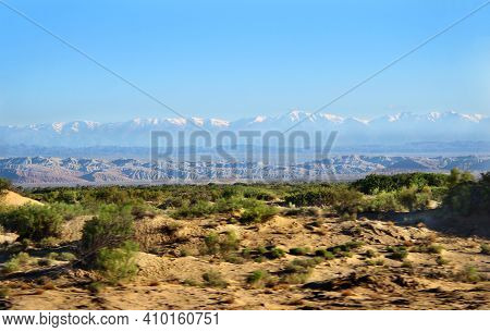 The Ridges Of The Cobbled Mountains In The Distance, A Large Snow-covered Ridge In The Distance, Cla
