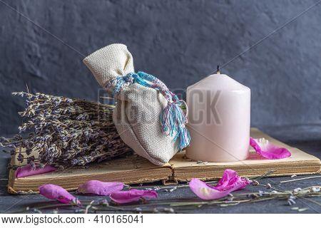 Magic Still Life With Pink Candle, Herb And Pagan Bag. Esoteric And Pagan Rituals, Witchcraft Wiccan