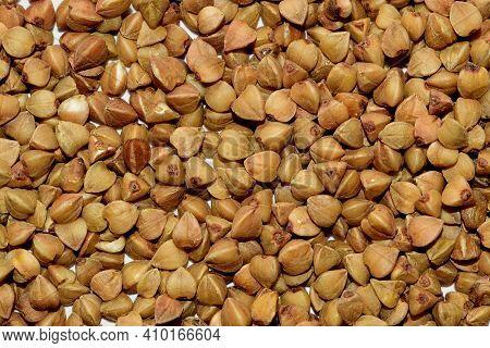 Macro Photo Of Buckwheat Groats. Grains Buckwheat Groat Texture Pattern For Background. Image Food P