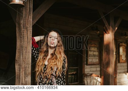 The Girl Meets The Morning Near The Western House, Traveling Alone. A Woman In A Village Outside The
