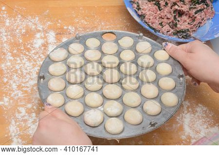 Round Mold For Sculpting Set Of Dumplings Or Ravioli. Home Cooking.