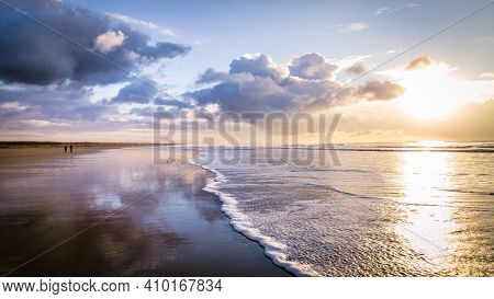 Walking Along The North Sea Coast And Beach During Sunset In Ijmuiden The Netherlands