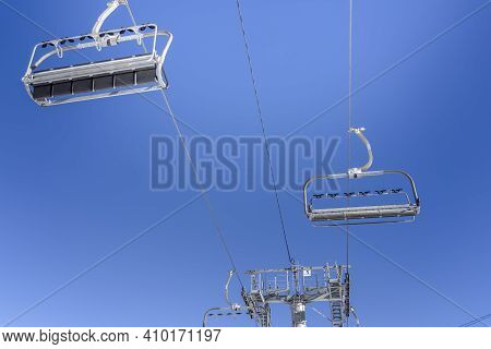 Empty Ski Slopes And Ski Lifts In Ski Resort. During The Winter Holidays 2021 Lifts Are Closed For S