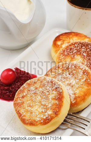 Cottage Cheese Pancakes Or Fried Cottage Cheese Pancakes, Sprinkled With Powdered Sugar, On A Plate