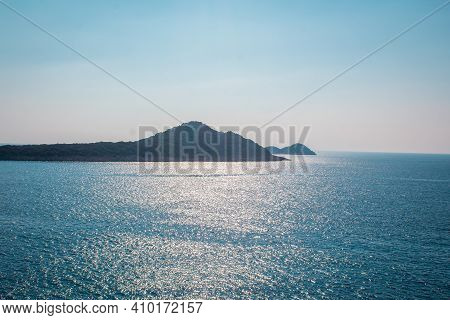 Islands In The Rough Sea. Islands In The Middle Of The Blue Sea. Distant Islands In The Middle Of Th