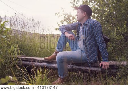 Caucasian Man Sitting Outdoor Resting After Hiking.