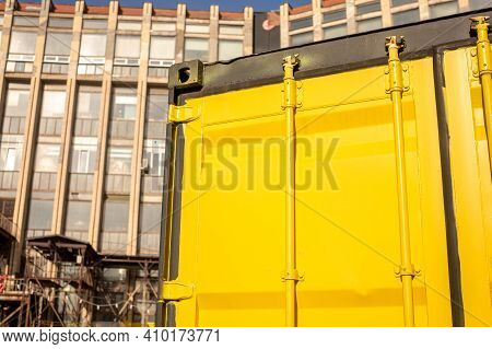 Yellow Sea Container. House From A Sea Container. Backgrounds And Textures