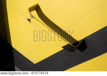 Iron Doorknob Handle On Iron In The Door. Yellow Paint. Ceometry. Falling Shadow