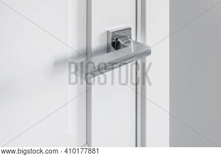 Modern Metal Door Handle On White Wooden Door In Interior. Knob Close-up Elements. Door Handle, Fitt