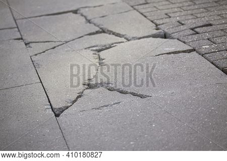 Sidewalk Pavement Tiles For Pedestrians Are Uneven Due To Lack Of Maintenance Can Cause Danger For P
