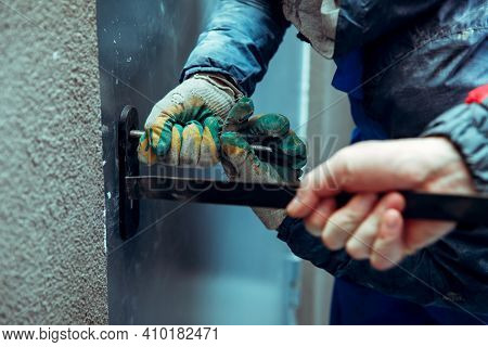 Thieves Robbers Breaks Open The Front Metal Door By Crowbar And Pickpockets - Improvised Tools. Hand