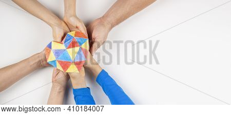 Family Hands Holding Colorful Paper Heart On White Background. Autism Spectrum Disorder Family Suppo