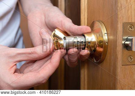 Install The Door Handle With A Lock, Man Hands Repair Door Knob, Repair Locking Mechanism
