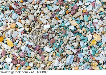 Sea Pebbles. Pebble Background. Wet Stones. Multi-colored Pebbles. Sea Shore. Rocky Texture From Nat