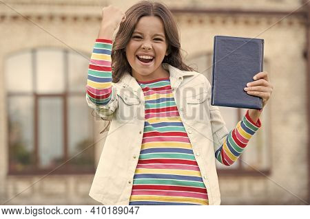 Little Girl Hold Book. Girl With Book Urban Background. Book From Library. Favorite Author. Being Re