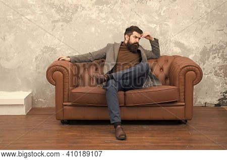 Beardy Hipster. Serious Hipster Relax On Sofa. Businessman With Hipster Beard. Barbershop Or Barbers