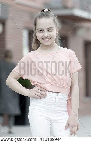 Natural Beauty. Beauty Look Of Smiling Small Girl On Urban Background. Little Child With Adorable Sm